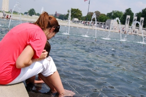 Cooling off at the WW II Memorial on a hot summer day.