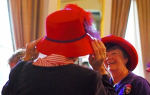 Two Red Hat friends hat shopping