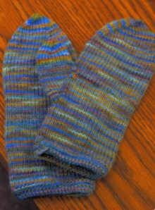A pair of mittens that only needed thumbs and finishing
