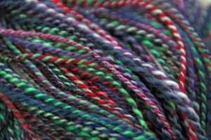 A collection of 6 differnt colors spun & plyed together